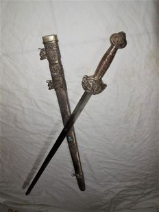 Old long sword/sabre from the Asian region covered with precious stones and mythical animals