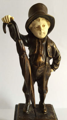A bronze male figure with head and hands of biscuit - on marble base - ca 1890