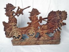 Wood carving depicting scene from the Mahabharata, Brata Yuda - Java - Indonesia