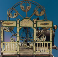 A model Ferris wheel of around 1910-1920 steam driven with coal fired steam boiler