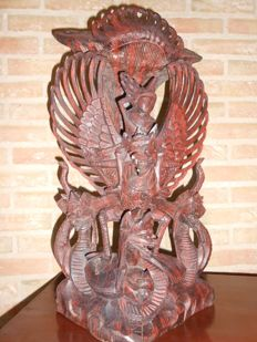 Large suar wood statue of Garuda and winged Naga - Bali - Indonesia