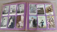 Album postcards including many French maps, art, young women, children, flowers, romance, embossed, gold imprint etc. 182 x