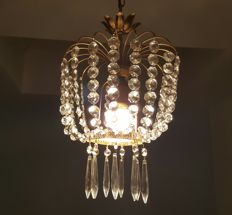 Small chandelier made of crystal glass.