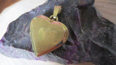 14 kt gold photo pendant in the shape of a heart