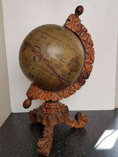 Large wooden globe on high wooden base