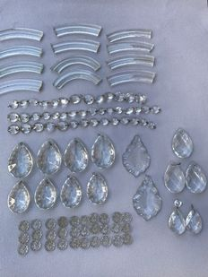 Antique French crystal pendants, rosettes and ornaments, ca. 100 pieces, ca. 1920, France