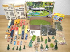 Faller/Kibri/Wiking/and others. H0 - 120471/and others - 49-piece set with which to enhance your track layout with trees, auto's, scatter material, and bridge onramps for C-rail [681]