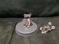 Swarovski - Kris Bear on skates and Kris Bear reclining.