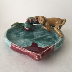 Majolica large bowl with eating monkey