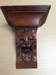 Richly carved oak console with lion's head - France - early 20th century