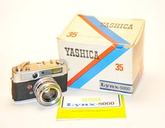 Yashica Vintage Rangefinder Camera LYNx 5000 no. LII 4020827 with camera body bag manual and box