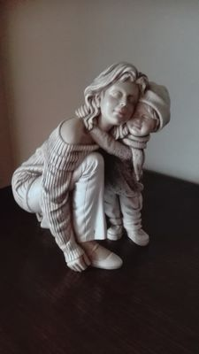 Wonderful sculpture of a mother with child, signed