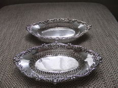 Pair of silver bon bon baskets , Chester , 1909