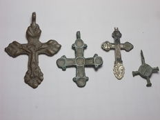 Lot of four Byzantine crosses - three made of bronze and one in silver - late Middle Ages
