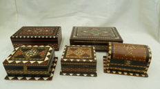 5 cases with bone inlay of which 1 music box and a cigarette case, and 3 smaller cases.