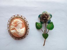 Pair of brooches – One with filigree cameo.