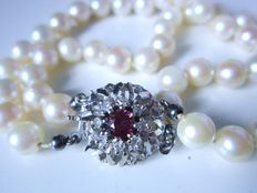 2 strand Akoya pearl bracelet with large clasp with ruby and diamonds made of 585 yellow gold!