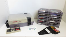 Nintendo NES incl controller, game genie and 20 games