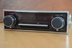 Pianola Electronic classic car radio with automatic tuning mechanism.