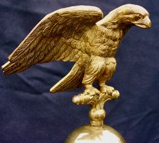 Golden, bronze flagpole from the 19th century