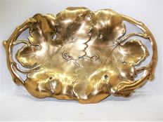 A beautiful brass fruit bowl in the shape of grape vines and leaves
