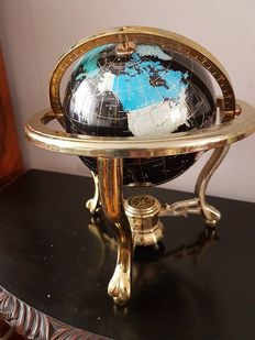 Globe with compass - large gemstone globe in a bronze/brass chair.