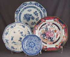 Collection of four octagonal plates with various decorations (including soft paste) – China – 18th and 19th century
