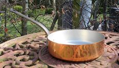 Set of copper pans, oven dish.