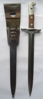 Swiss long model 1918 early bayonet (personalised with name!), complete with sheath and holder in excellent condition.