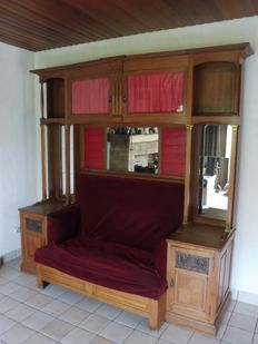 Beautiful art nouveau wall sofa with cabinets, open shelves and mirrors