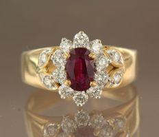 18k yellow gold ring set with a central oval cut ruby of in total approx. 1.00 carat and 14 brilliant cut diamonds of in total approx. 0.68 carat ***NO RESERVE PRICE***