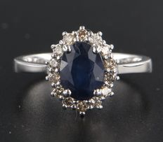 14k white gold rosette ring set with a central oval cut sapphire total of approximately 1.60 carats with 14  entourage brilliant cut diamonds, in total approximately 0.28 carats *** NO RESERVE PRICE ****