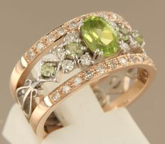 14kt bi-colour gold ring set with peridot and single cut diamonds with a total of 0.45 carat