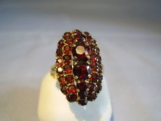Large antique ring with round faceted blood-red Bohemian garnets