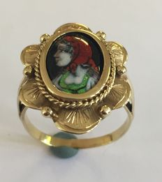 Gold ring with a female portrait in enamel.