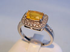 Rare cocktail ring with fire opal and white topaz entourage