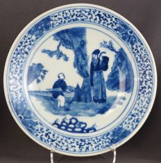 Plate with a depiction of a boy and a dignitary in a rocky landscape, China, nineteenth century