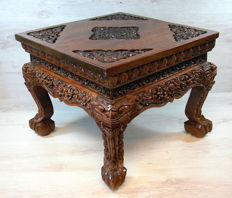 Hand-carved, wooden side table, richly decorated - Central Java - Indonesia.