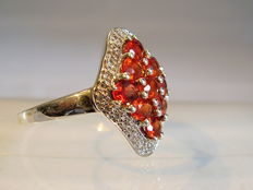 A ring with rare red Songea sapphires of 2.20 ct in total.