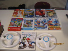 Wii lot of 8 games,2 controllers(motion plus) and 2 wheels for Mario Kart .