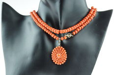 Old Dutch precious coral necklace with a 14 kt gold clasp and a large silver pendant, long model.