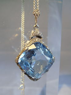 Silver pendant with light blue spinel approx. 30ct on silver chain