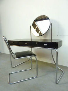 Designer unknown – Dressing table / desk and a chair with a tubular frame, with a modernist design.