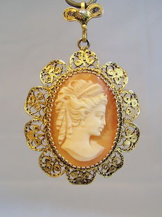 Victorian filigree pendant with hand-carved shell cameo