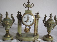 Pendulum clock set signed on a column of marble and bronze, complete with key, pendulum and weights. From a French chateau, made around 1890.