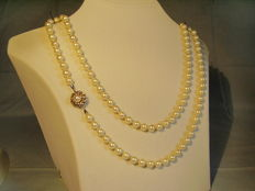Genuine long white Akoya pearl necklace with 14 kt gold clasp