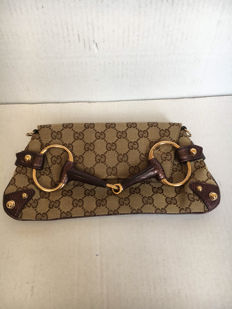 Gucci - horse bit chain clutch.