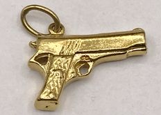 18kt solid gold pendant in the shape of a gun - measurements are 1.5 x 2 cm.