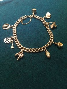 18 kt gold bracelet with charms