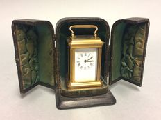 Small carriage clock in an antique case, clock dates from the late 20th century